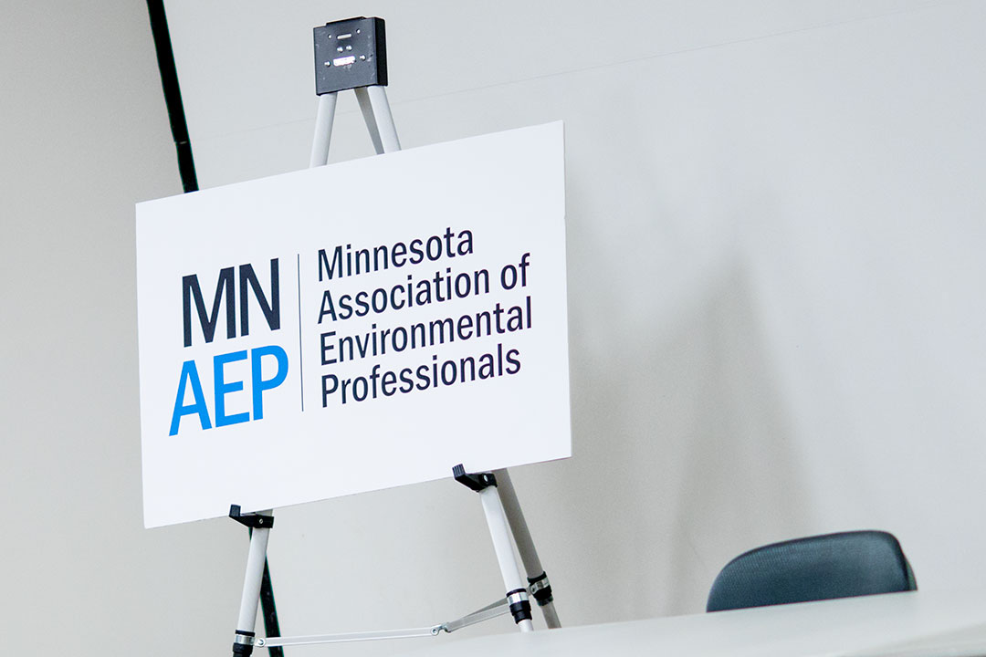 MNAEP logo printed on foam core sitting on easel